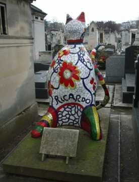 OK, this isn't his grave but it was just down the row and is probably the most bizarre grave I have ever seen